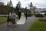 Bride and father arriving for wedding at Ardverikie Estate