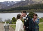 Kissing the bride at Ardverikie Estate wedding