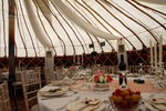 Set table inside wedding yurt