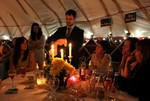 Magician does tricks in yurt at wedding reception