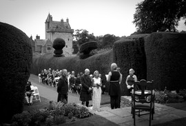 Marriage ceremony on the lawn at Guthrie Castle, Forfar