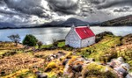 Red roofed cottage Scottish Highlands